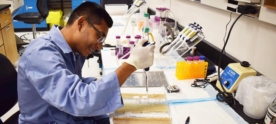 Science Ambassador Eddie Vargas working in a lab